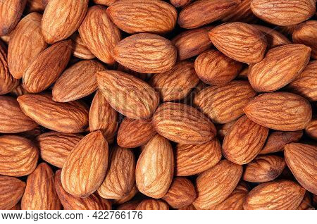 Background Of Almonds. Fried Almonds. Scattered Almond Grains. Background For Advertising, Layout, M