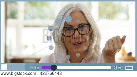 Composition of businesswoman talking on video playback interface screen. global business communication technology concept digitally generated image.
