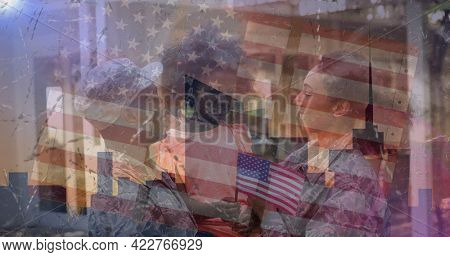 Composition of male and female soldiers embracing smiling daughter over american flag. soldier returning home to family concept digitally generated image.