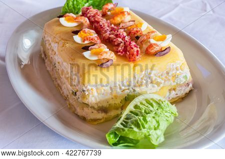 Causa Limena, A Typical Dish In Peruvian Cuisine Served With Onions, Crayfish And Quail Eggs