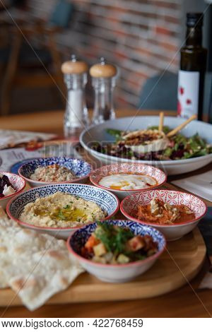 Business Lanch In A Turkish Restaurant With Appetizing Dishes.