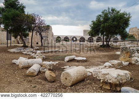 Inner Courtyard Of Medieval Castle Kizkalesi. There Are Remains Of Columns, Decors Of Pylons, Ruins