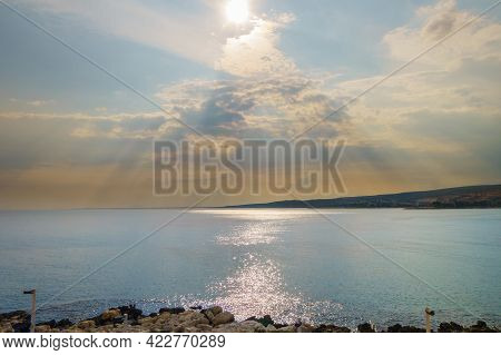 Panoramic View Onto Mediterranean Shoreline, Lighted By Sun. Sun Rays Make Their Way Through Clouds