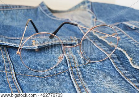 Eye Glasses With Round Metal Frames On The Pocket Of A Blue Denim Jacket, Trend Eyes Glasses, Retro