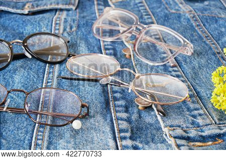 Yellow Wildflowers And Multiple Eye Glasses On A Blue Denim Jacket, Trend Eyes Glasses, Retro Style