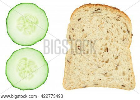 Sliced Fresh Cucumber And A Slice Of Bread On An Isolated White Background.