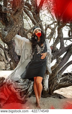 Beautiful Young Gypsy Style Woman With Red Rose Outdoors