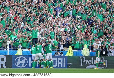 Lyon, France - June 16, 2016: Irish Fans On Tribunes Of Stade De Lyon Stadium Celebrate After Their