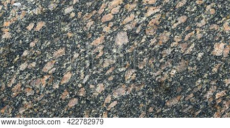 Closeup Of A Granite Stone Surface. Pink And Black Texture Of A Polished Natural Crystalline Rock As