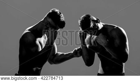 Two Young Boxers Facing Each Other In A Match. Two Men Boxers Boxing On Isolated Silhouette Backgrou
