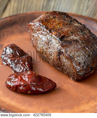 Grilled Strip Steak Garnished With Chipotle Peppers