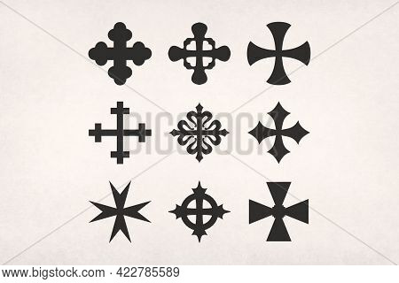 Nine Different Shape Of Crosses Printed On Paper.