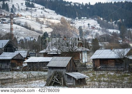 Old Historical Wooden Houses In The Carpathian Mountains At Winter. Vorokhta, Ukraine
