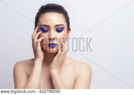 Makeup Asian Woman Close Eyes Show Blue Color Eyeshadow With Extreme Long False Eyelashes. Eyelash E