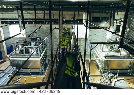 Mechanical Engineer Team Working Installation Condensing Unit System In Machine Room For Cold Storag