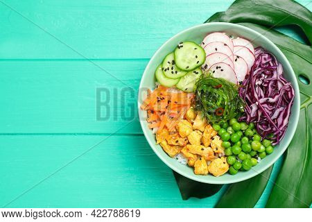 Delicious Salad With Chicken, Vegetables And Seaweed On Turquoise Wooden Table, Top View. Space For