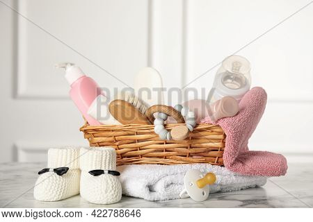 Baby Booties And Accessories On White Marble Table Indoors