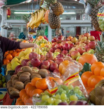 Woman Hand Choose Fruit At Fresh Fruit Produce Local Market. Counter Of Street Market Stall With Var