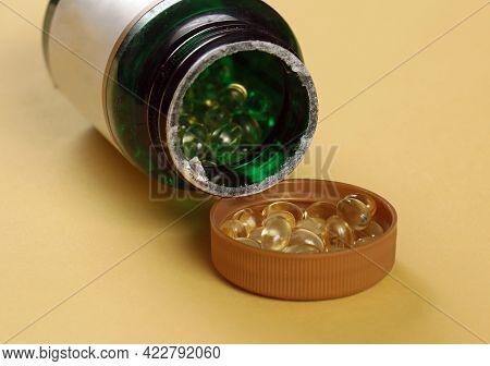 Vitamin D Supplement Gel Pills Pile Inside Container Plastic Lid