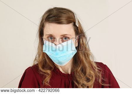 Young Beautiful Woman With Medical Face Mask Protection From Coronavirus