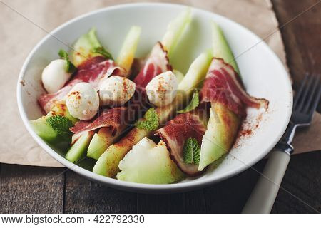 Melon With Prosciutto, Mozzarella Balls And Mint, Close-up.