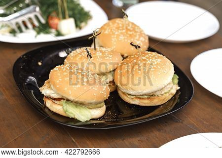 A Plate With Burgers On A Festive Table. Catering Service.