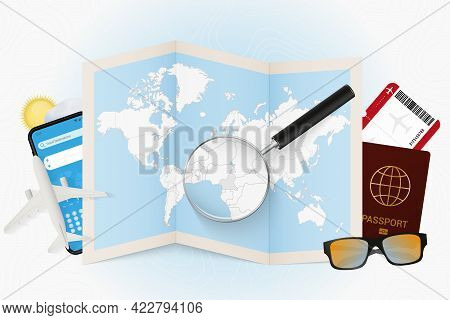 Travel Destination Cameroon, Tourism Mockup With Travel Equipment And World Map With Magnifying Glas