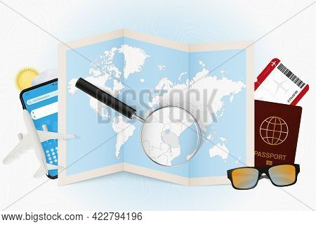Travel Destination Tanzania, Tourism Mockup With Travel Equipment And World Map With Magnifying Glas