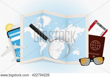 Travel Destination Zimbabwe, Tourism Mockup With Travel Equipment And World Map With Magnifying Glas