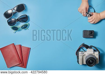 Creative Concept Of A Flat Trip With Cameras, Sunglasses And Passports For A Family Of Three. The Co
