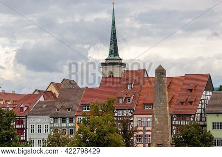Facades Of Half-timbered Houses And A Church Tower In The Background In Erfurt, Thuringia