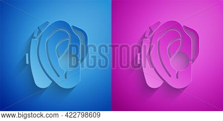 Paper Cut Hearing Aid Icon Isolated On Blue And Purple Background. Hearing And Ear. Paper Art Style.