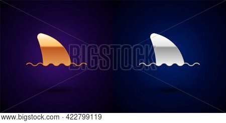 Gold And Silver Shark Fin In Ocean Wave Icon Isolated On Black Background. Vector