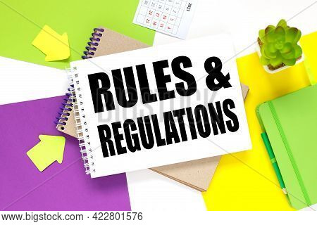 Rules And Regulations. Notepad On A Colorful Background. White Purple And Yellow Background.