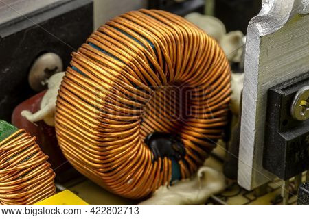 An Inductor, Toroidal Coil On A Ring With Visible Copper Scroll, Wound On A Magnetic Coil.
