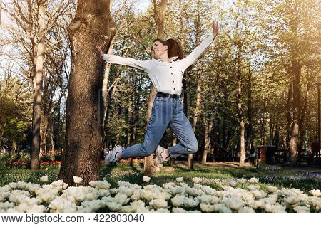Enjoy Every Moment, Enjoying Life, Positive Emotions, Ways To Be Happier. Happy Young Woman Jumping