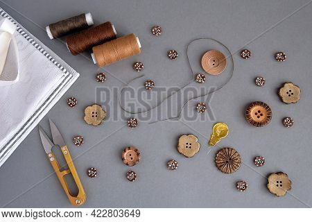 Set Of Accessories For Sewing And Needlework: Buttons, Scissors, Needle With Thread, Brown Threads,
