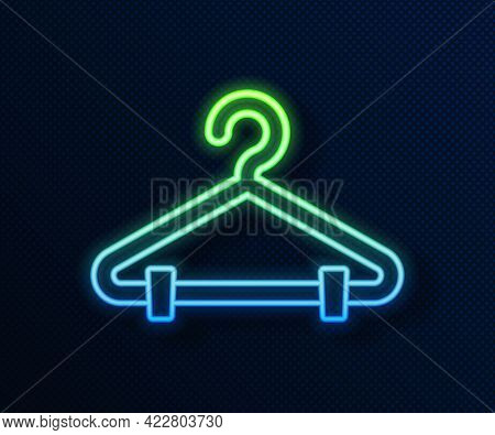 Glowing Neon Line Hanger Wardrobe Icon Isolated On Blue Background. Cloakroom Icon. Clothes Service