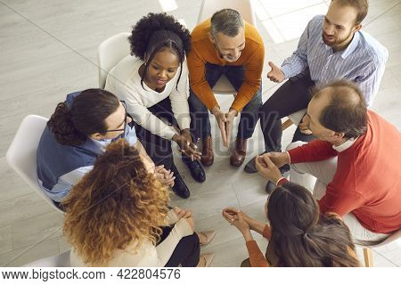 Diverse Patients Talking In Friendly Positive Atmosphere Of Group Therapy Session
