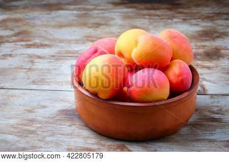 Heap Of Ripe Juicy Apricots On A Table. Rustic Style. Crop Of Apricots