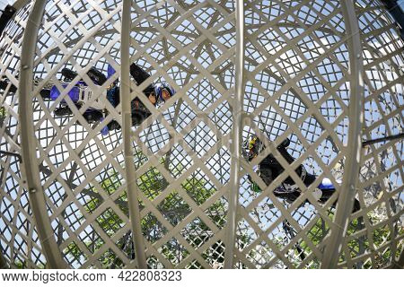 Bucharest, Romania - June 5, 2021: Two Circus Acrobats Ride Their Motorbikes Inside A Metal Sphere D