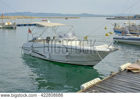 White Motorboat At The Pier Ready For Marine Journey. Spain L Estartit, July 5 2018