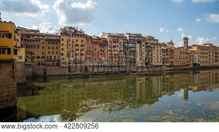 Buidings At Ponte Vecchio Famous Landmark Reflected On Arno River. Florence, Tuscany Italy.