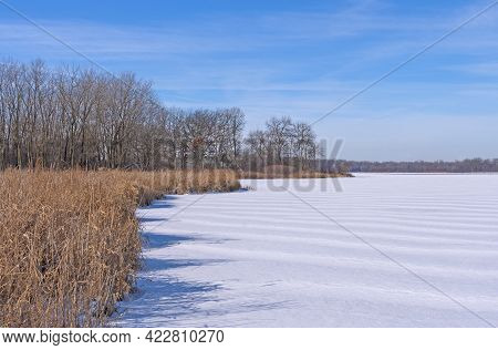Frozen Lake Meets The Prairie In Winter In Ned Brown Preserve In Illinois