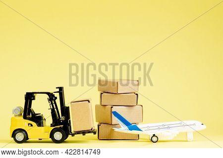 Mini Forklift Truck Load Cardboard Boxes In The Airplane. Fast Delivery Of Goods And Products. Logis
