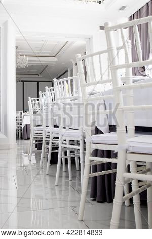 White Chairs, White Tablecloths On The Tables In The Restaurant