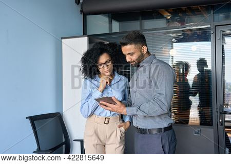 Concentrated Indian Male Ceo Businessman And Female African American Financial Manager Working On In