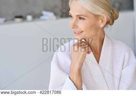 Headshot Of Happy Smiling Gorgeous Middle Aged Woman In Bathrobe At Spa Hotel Looking Away. Advertis