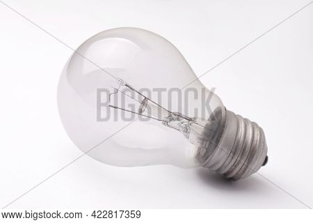 Vintage Retro Filament Lamp Light Bulb Laying On White Table