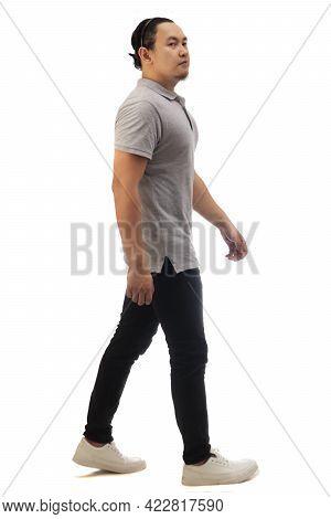 Asian Man Wearing Grey Shirt Black Denim And White Shoes, Walking Forward, Side View, Happy Confiden